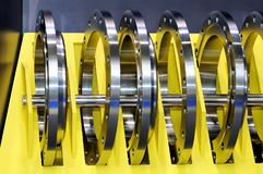 Industrial metal rings on a yellow stand Stock Photos