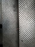 Two metal panels with variation and shadows, diamond shape pattern repeating royalty free stock image