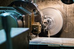 Industrial metal work bore machining process by cutting tool on automated lathe.  stock images