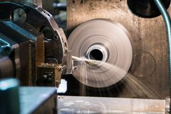 Industrial metal work bore machining process by cutting tool on automated lathe.  royalty free stock images