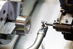 Industrial metal work machining process by cutting tool on CNC l. Athe Royalty Free Stock Photo