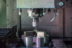 Industrial metal work machining. Process by cutting tool on CNC lathe Royalty Free Stock Photos