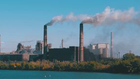Industrial, Metallurgical Plant in the City Working at Full Power. Smoke from Pipes. Throws toxic substances into the atmosphere. Heavy smoke, vapor and stock video