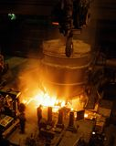 Industrial metallurgy. Liquid iron from the smelting stove Stock Photos