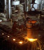 Industrial metallurgy. Molten liquid iron is poured. Iron casting Stock Image