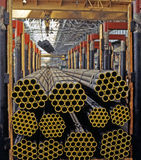 Industrial metallurgy. Seamless pipes made of corrosion-resistant steel. Warehouse Stock Photography