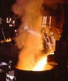 Industrial metallurgy. Glowing, molten hot steel Stock Photography
