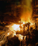 Industrial metallurgy. Molten liquid iron is poured. Iron casting Royalty Free Stock Image