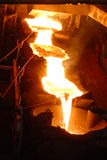 Industrial metallurgy. Glowing, molten hot steel. Stell casting Stock Image