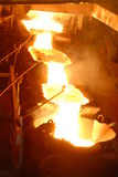 Industrial metallurgy. Glowing, molten hot steel. Stell casting Royalty Free Stock Photos