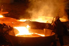 Industrial metallurgy. Glowing, molten hot steel. Stell casting Royalty Free Stock Images