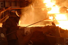 Industrial metallurgy. Glowing, molten hot steel. Stell casting Stock Photos