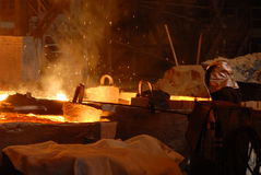 Industrial metallurgy. Glowing, molten hot steel. Stell casting Royalty Free Stock Image