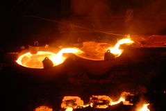 Industrial metallurgy. Glowing, molten hot steel. Stell casting Royalty Free Stock Photo