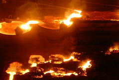 Industrial metallurgy. Glowing, molten hot steel. Stell casting Stock Photo