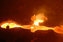 Industrial metallurgy. Glowing, molten hot steel. Stell casting Stock Images