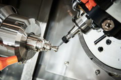 Industrial metalworking cutting process by CNC milling cutter stock photography