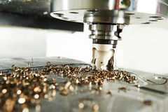 Industrial metalworking cutting process by milling cutter royalty free stock photo
