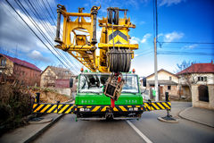 Industrial mobile crane with hydraulic and telescopic rack. Operating on work construction site Stock Images