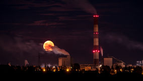 Industrial moon. Taken near Kwidzy, Poland shows pollution spreading over the city at night - when no one see. The factory produce paper Stock Photo