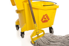 Industrial Mop and bucket close-up. Close-up of Industrial mop and bucket isolated on white background with paths Stock Photography