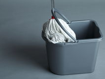 Industrial mop and bucket. On grey background Royalty Free Stock Photo