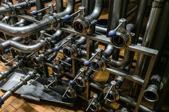 Multichannel distribution of steel pipes with shut-off valves. Industrial multichannel distribution of steel pipes with shut-off valves royalty free stock images