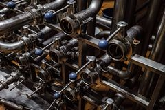 Multichannel distribution of steel pipes with shut-off valves. Industrial multichannel distribution of steel pipes with shut-off valves royalty free stock image