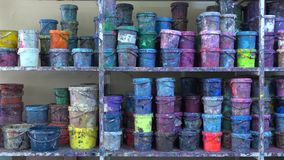 Industrial multicolor paint buckets storage 4K dolly shot stock footage