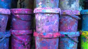 Industrial multicolor paint buckets storage 4K dolly shot, close up version stock video footage