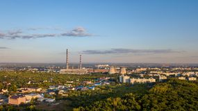 Industrial near city. Industrial building heat station factory near summer city, aerial view stock images