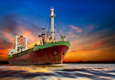 Industrial ocean ship. On the sunset background stock photography