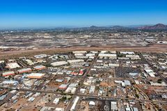Industrial and office buildings adjacent to airport. Viewed from above stock photo