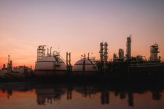 Industrial. Oil and gas refinery plant on sky sunset background Stock Photo