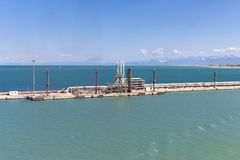 Oil loading and discharge station for tanker ships in a harbor Royalty Free Stock Photography