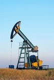 Industrial oil pump. Isolated oil rig on sunset Stock Photo