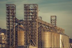Industrial oil steel towers tanks or storages for petroleum, fuel. Petrochemical industry. Vintage toned royalty free stock photography