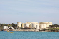 Industrial oil tanks. Industrial round oil tanks close the the coast in the mediterranean Stock Photography