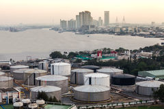 Industrial oil tanks in a refinery with building cityscape Stock Photo