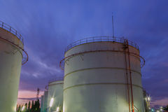 Industrial oil tanks in a refinery at twilight Royalty Free Stock Images