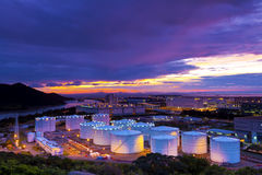Industrial oil tanks at sunset Stock Photos
