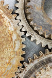 Industrial old corroded gears for machinery on scratched backgro Royalty Free Stock Photography