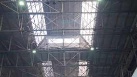 Industrial old metal structures. Old industrial warehouse with metal beams under ceiling in large heavy plant stock footage