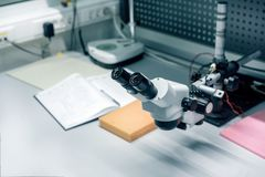 Industrial optical microscope. Workplace for quality control of electronic circuit boards.  Stock Image