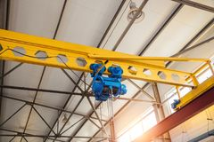 Industrial overhead crane in factory. Hoist of Industrial overhead crane in factory. Close up Stock Photo