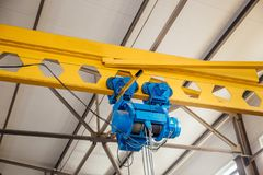 Industrial overhead crane in factory. Hoist of Industrial overhead crane in factory. Close up Royalty Free Stock Images