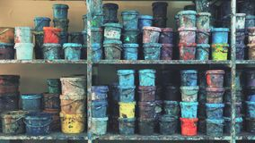 Industrial paint warehouse full of colorful stained buckets stock video
