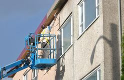 Industrial Painter Working Outside Stock Photo