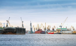 Industrial panorama with cranes and docks Royalty Free Stock Photos