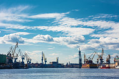 Industrial panorama with cranes and docks. Neva River, St.Petersburg, Russia Royalty Free Stock Photos